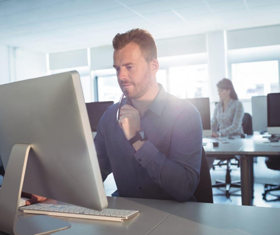 Man at computer Choosing the right cloud provider